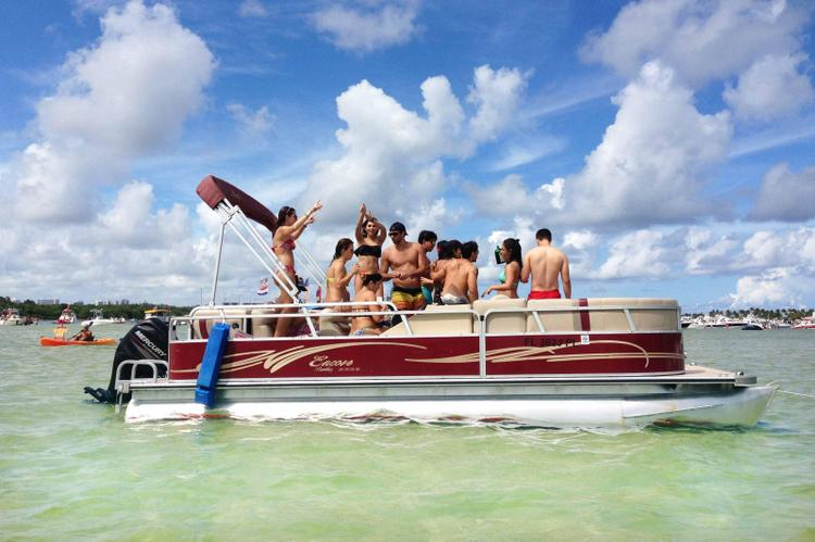 Up to 12 persons can enjoy a ride on this Pontoon boat