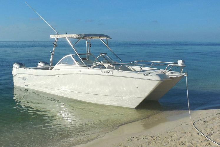 Discover Key West surroundings on this 250DC World Cat boat