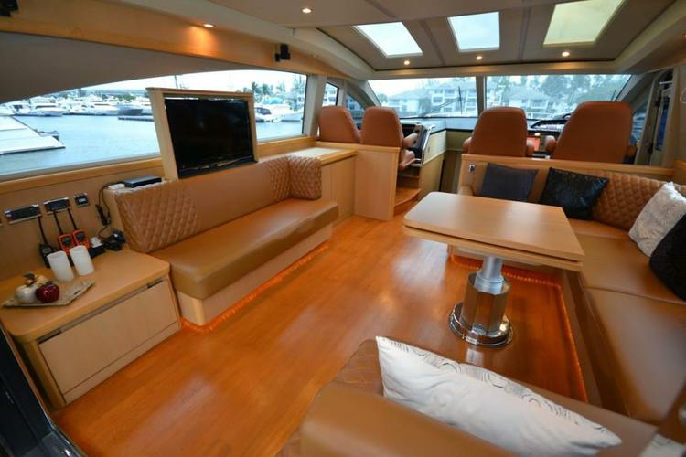 Discover Miami Beach surroundings on this 70 Convertible Viking boat
