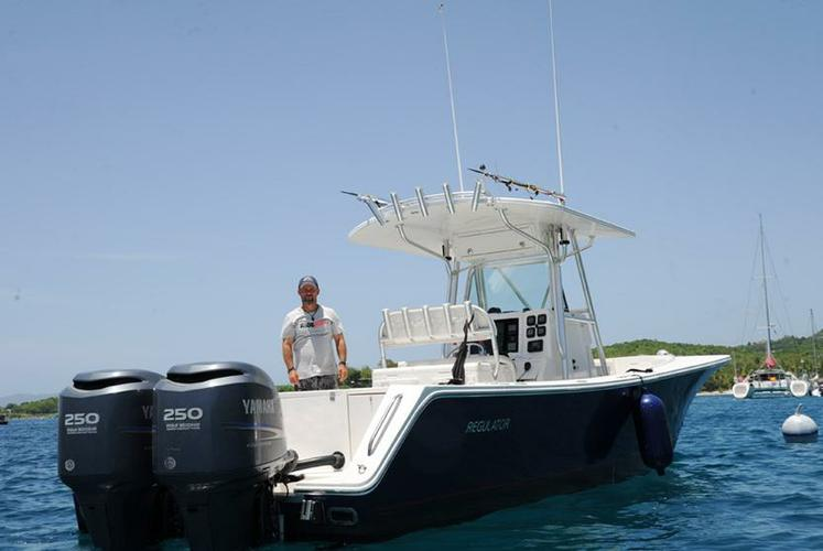 Discover Cruz Bay surroundings on this 32FS Regulator boat