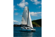 Relax with a cocktail while sailing the beautiful bays of BVI