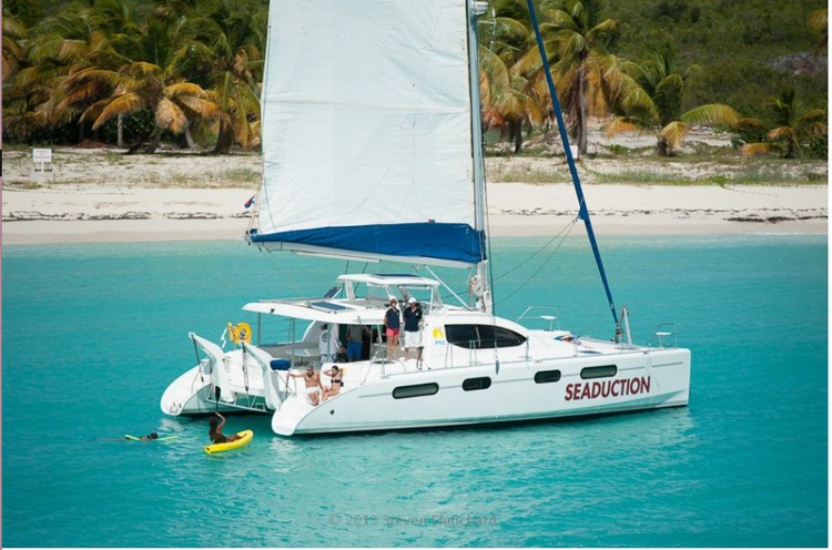 This 46.0' Robertson and caine cand take up to 15 passengers around