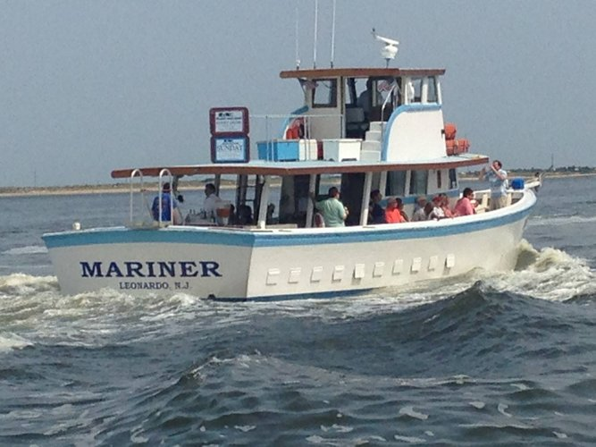 Discover Atlantic Highlands surroundings on this Wooden Boat Chesapeake boat