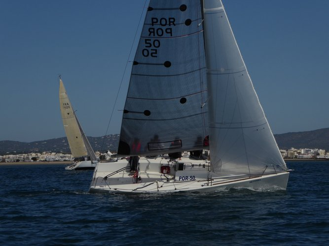 Discover Faro surroundings on this Platu25 Beneteau boat