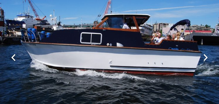 Discover Seattle surroundings on this Cabin cruiser Thomley boat