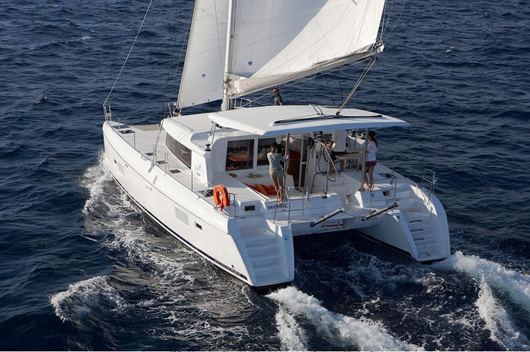Climb aboard 42' cruising catamaran to explore Italy