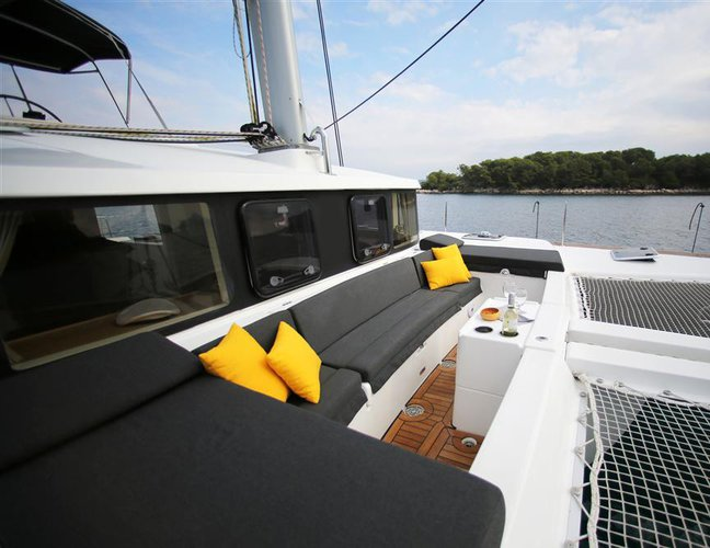 Discover Alcantara surroundings on this 440 Lagoon boat