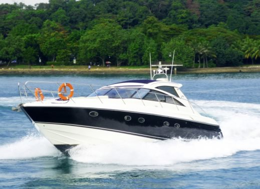 Discover Sentosa Cove surroundings on this Princess V48 Custom boat