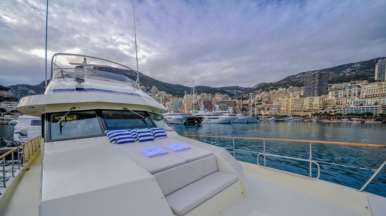 Discover Monte Carlo surroundings on this 70 Hatteras boat