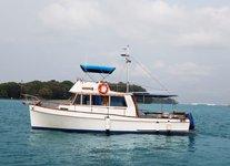 Charter a 40' Sedan Classic in Sentosa Cove, Singapore