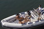 Discover Lisboa surroundings on this Rigid Inflatable Boat Flybridge boat