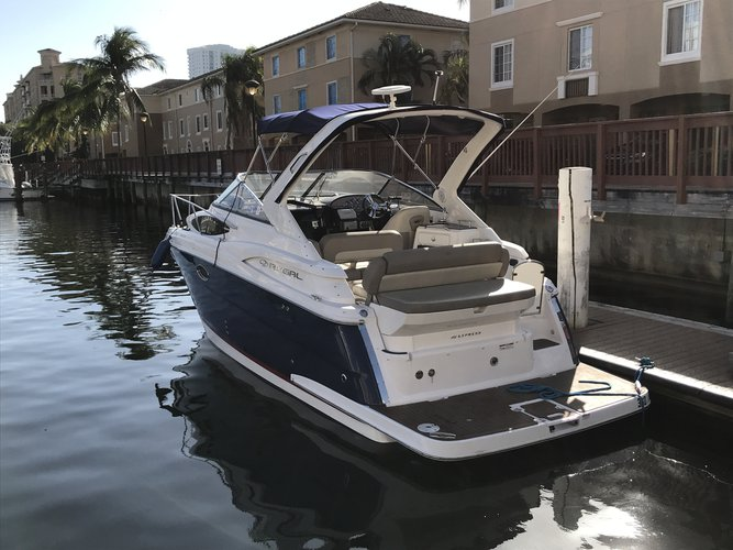 Discover Aventura surroundings on this 30 Express Regal boat