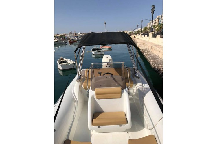 Inflatable outboard boat rental in Msida,