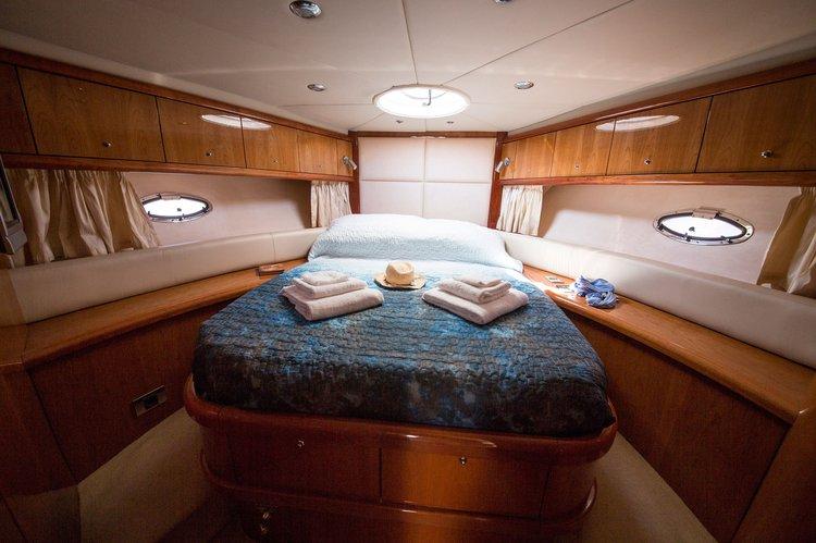 Discover Gzira surroundings on this Portofino 46 Sunseeker boat