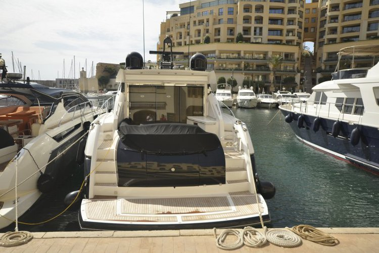 Discover St Julian's surroundings on this Predator 62 Sunseeker boat