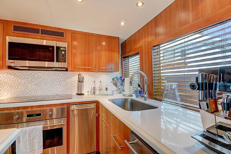 Discover Miami Beach surroundings on this 100' Hatteras boat
