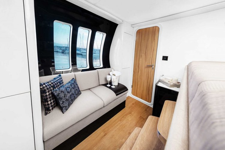 Discover Road Town surroundings on this 58 Wave boat