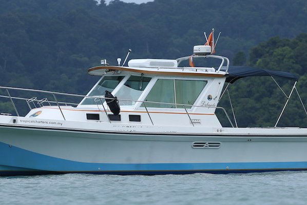 Discover Malaysia in style boating  on this elegant motor boat rental