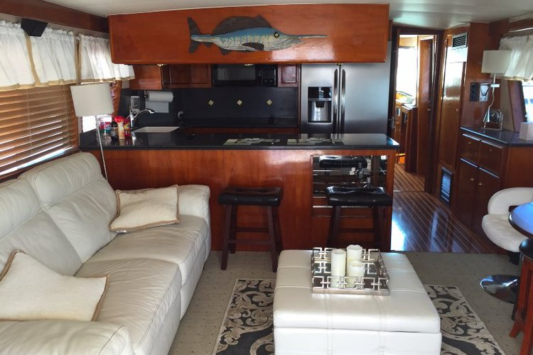 Discover San Diego surroundings on this 60 Hatteras boat