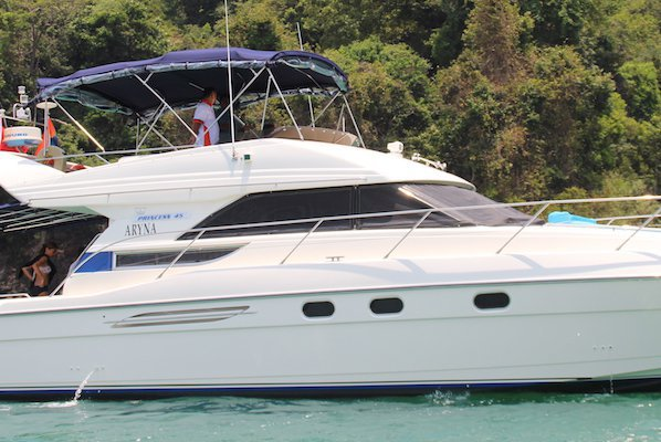 Have fun in the sun on this Flybridge motor yacht charter
