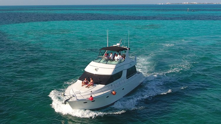Take this awesome Carver 55 ft motor boat for a spin!