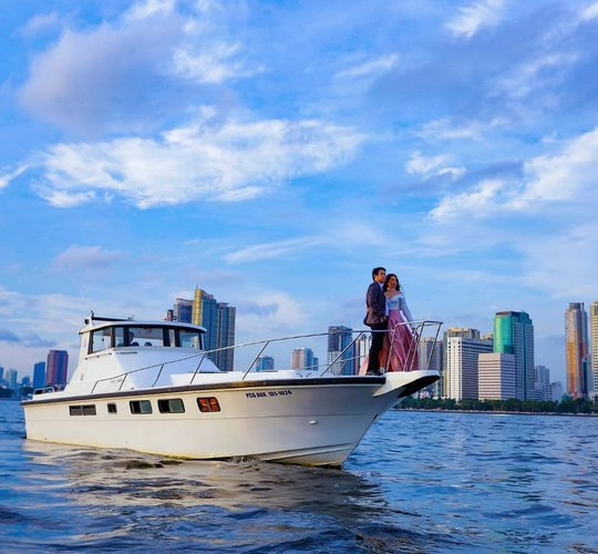 Discover Philippines in style boating on this motor yacht charter