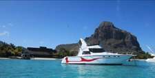 Discover Mauritius in style boating on this motorboat charter