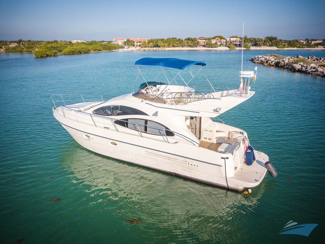 Discover Puerto Aventuras in style boating on this motor yacht charter