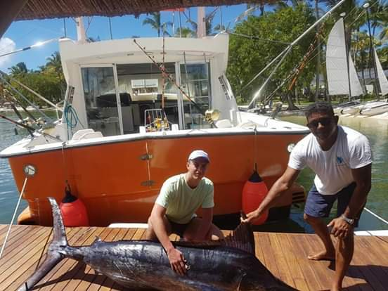 Discover Port Louis surroundings on this Custom Custom boat