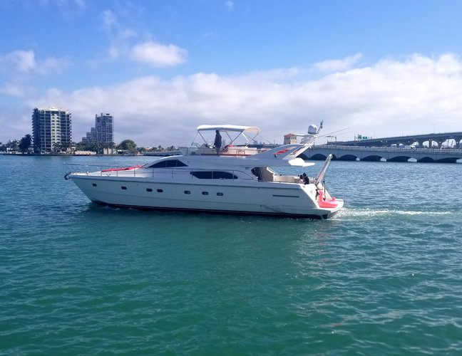 Discover Miami surroundings on this Ferretti Flybridge Ferretti boat