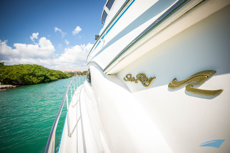 Enjoy luxury and comfort on this Puerto Aventuras motor yacht rental