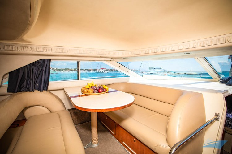 Discover Puerto surroundings on this 400 Sedan Sea Ray boat