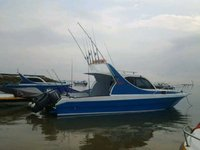 Uncover Bali  in style boating on this motor boat rental