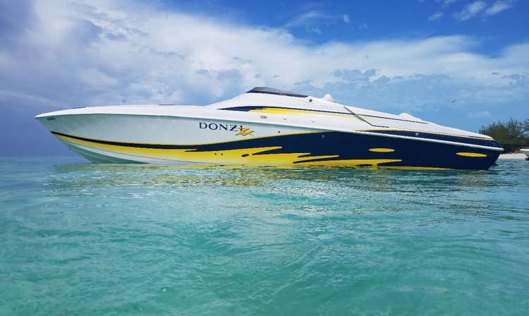 Relax and have fun on this gorgeous Donzi 38ZR boat charter