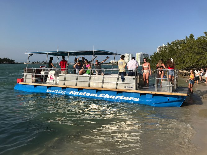 Up to 13 persons can enjoy a ride on this Pontoon boat