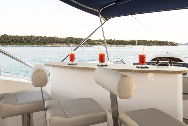 Discover Barcelona surroundings on this 65 Azimut boat