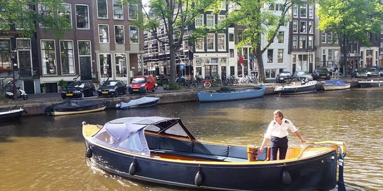 Discover Amsterdam in style boating on this electric boat rental
