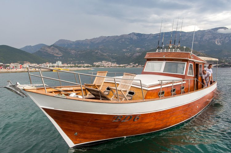 Hop on board Capt. Stefan's beautiful 39' wooden boat 'Mozart'.
