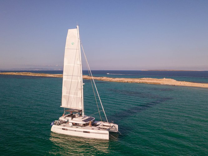 Discover Balearic Islands surroundings on this 52 F Lagoon boat