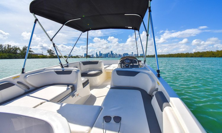 Boating is fun with a Deck boat in Key Biscayne