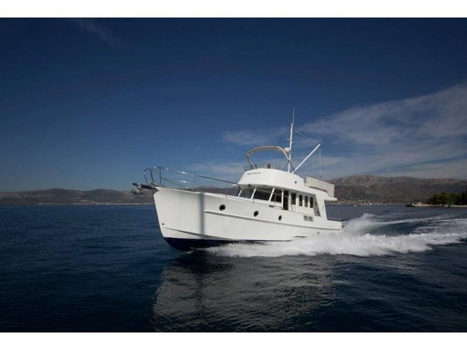 Sail the beautiful waters of Zadar on this cozy Beneteau Swift Trawler 42
