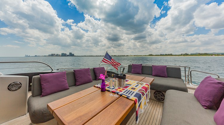 Discover Aventura surroundings on this 92' Mangusta boat