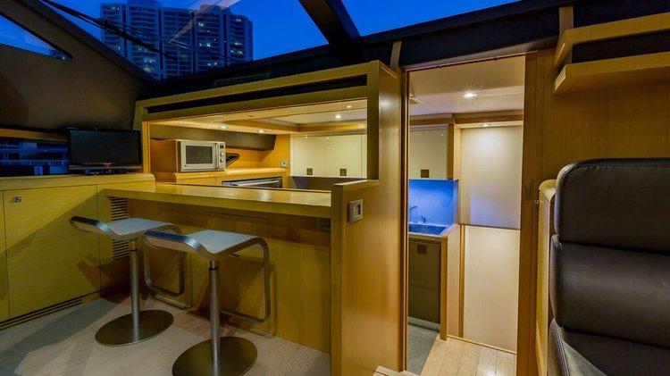 Discover Miami Beach surroundings on this 2011 Ferretti boat