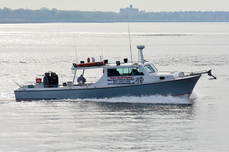 Discover Flushing surroundings on this 46 foot charter boat Harrison boat