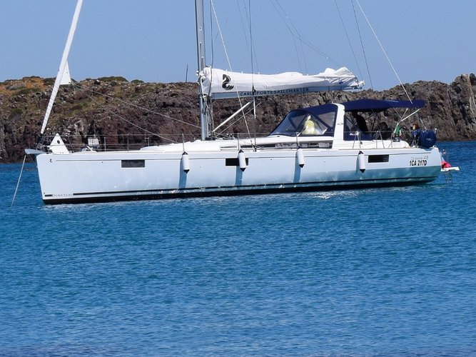 Sail the beautiful waters of Alghero on this cozy Beneteau Oceanis 48