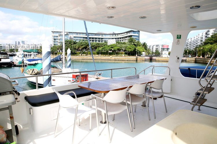 Boating is fun with a Mega yacht in Marina Sentosa Cove