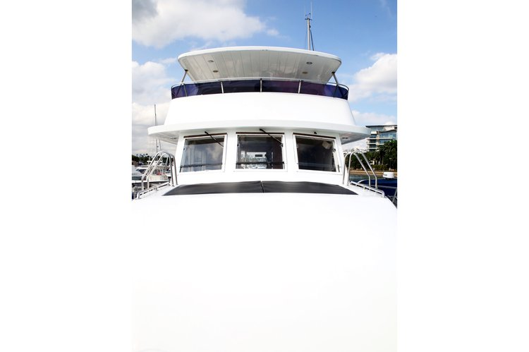 This 57.0' Custom cand take up to 37 passengers around Marina Sentosa Cove