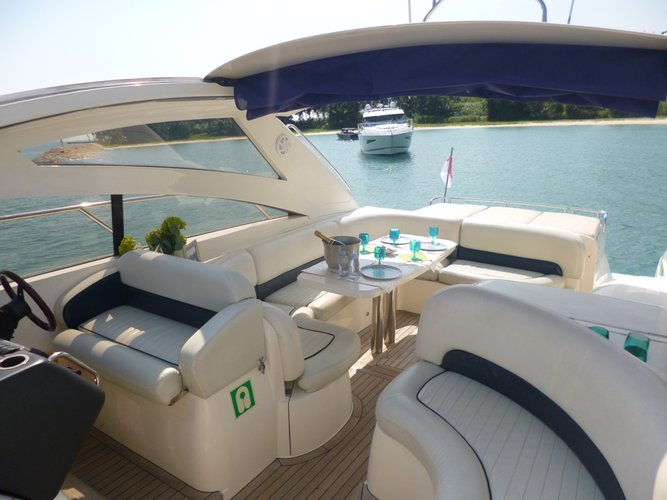 This 48.0' Princess cand take up to 14 passengers around Marina At Keppel Bay