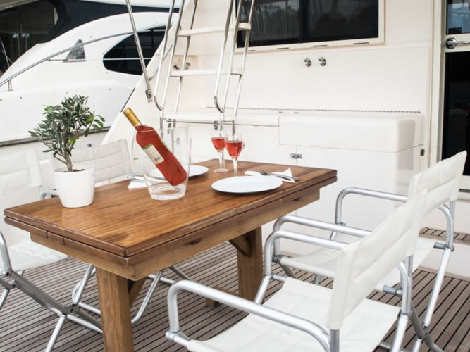 Discover Alimos surroundings on this Riviera 48 Riviera boat