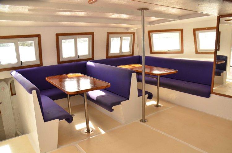 Discover Trou D'Eau Douce surroundings on this Custom Custom boat